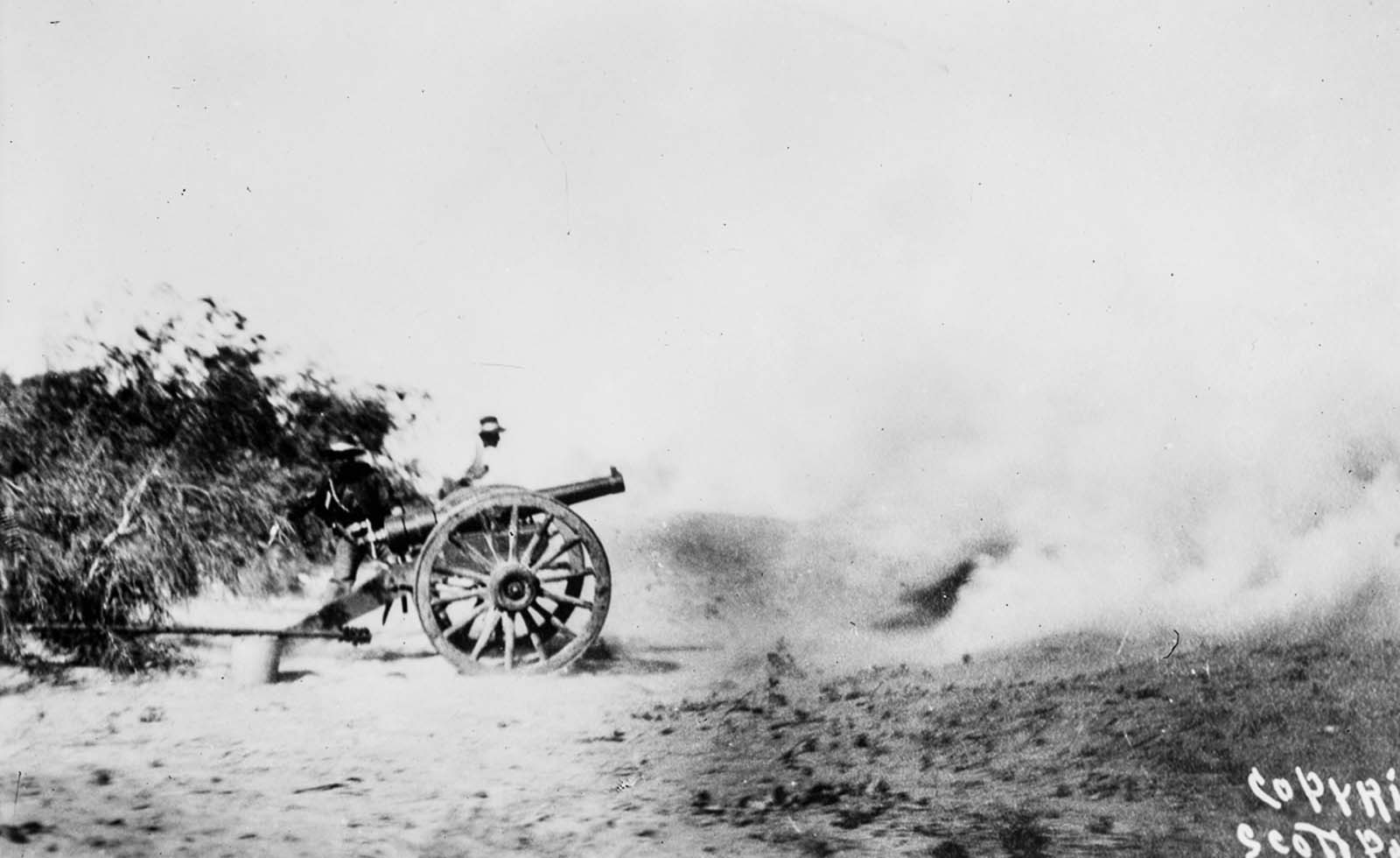 Rebels fire on Ciudad Juárez with a cannon.
