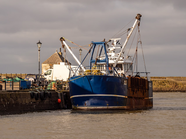 Photo of a fishing boat in Maryport Harbour