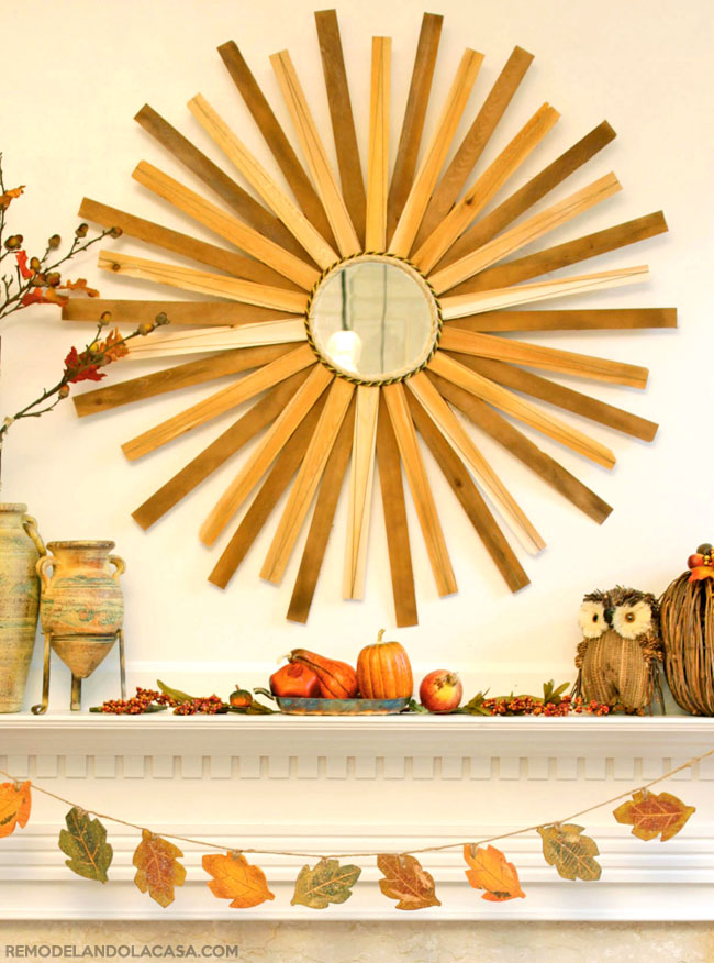 Fall mantel with mirror and owl and leaves garland