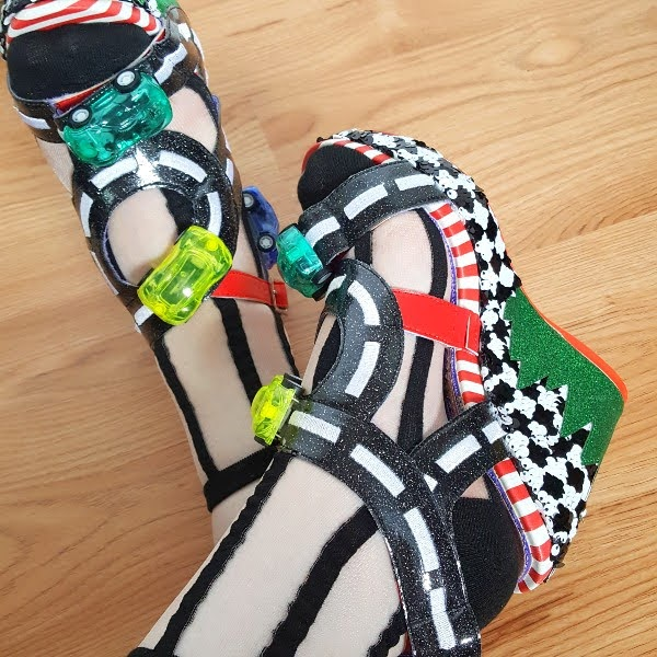 elasticated section in strap on wedge shoes