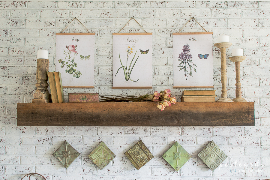spring mantel with vintage botanical art and architectural salvage