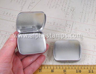 http://www.alphastamps.com/p18196/Small_Hinged_Tins/product_info.html