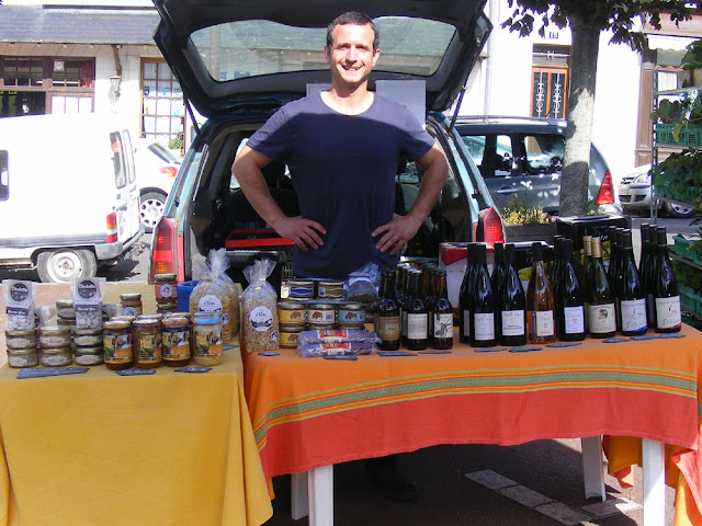 Specialist local groceries stall at a village market, Indre et Loire, France. Photo by Loire Valley Time Travel.