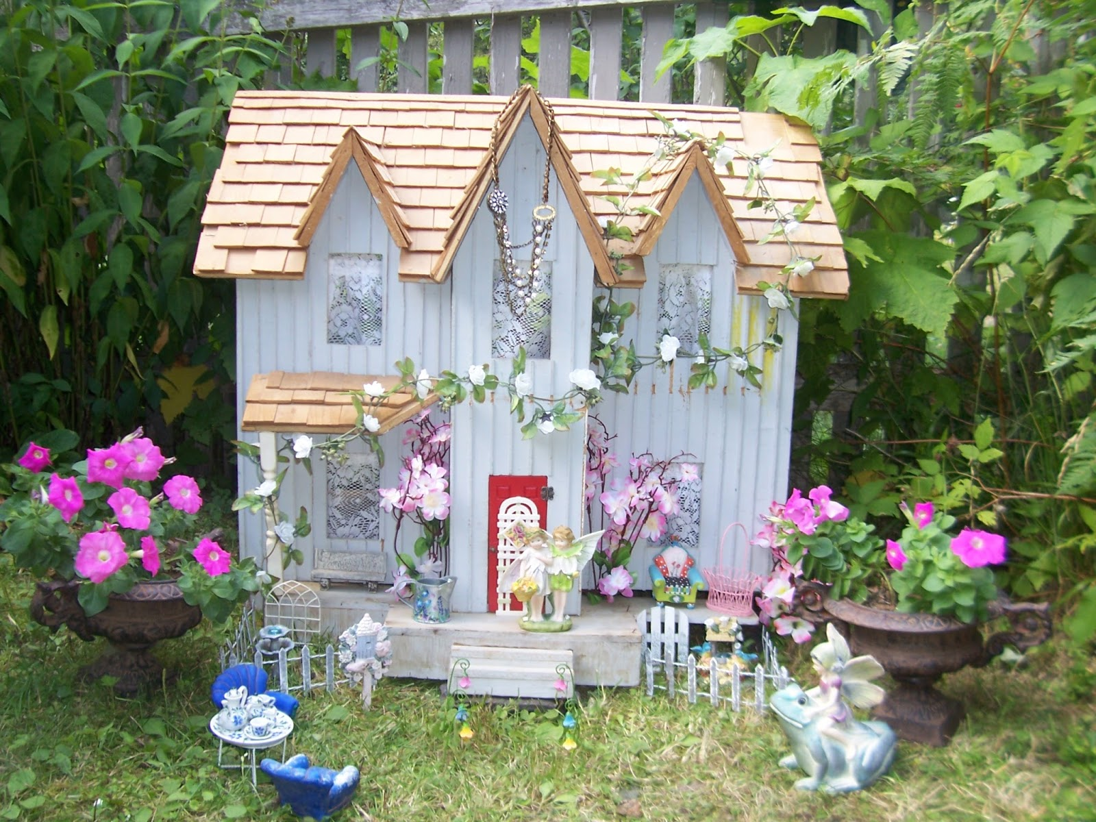 two cottages and tea garden fairy house