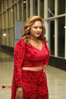 Actress Nikesha Patel Pictures in Red Dress at Araku Road Lo Audio Launch  0015.JPG