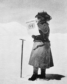 Fanny Bullock Workman on Silver Throne Plateau (21,000 feet) holding a 'Votes for Women' newspaper