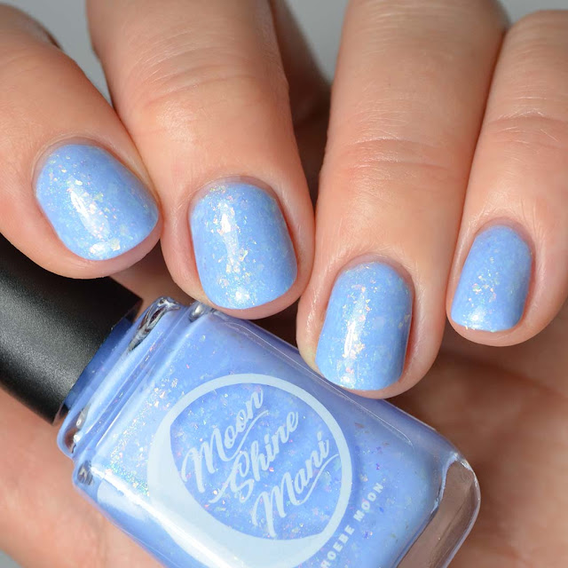 periwinkle blue nail polish with flakies swatch
