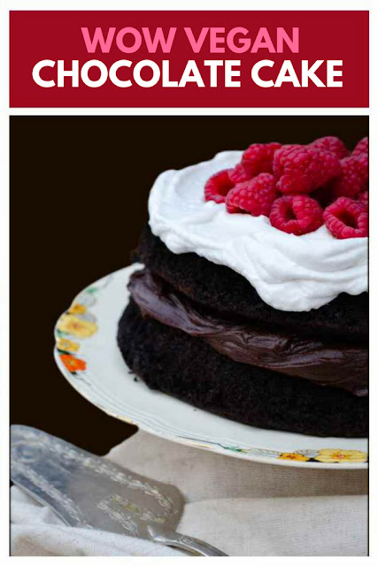 An indulgent chocolate cake filled with chocolate buttercream and topped with whipped coconut cream and raspberries. #veganchocolatecake #vegancake #veganbirthdaycake #veganbaking #chocolatecake #chocolate #cake #dairyfreecake #eggfreecake #freefromchocolatecake