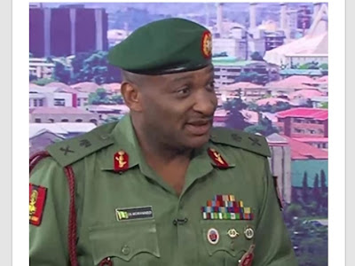 Nigeria military chief warns against using phone at check point.