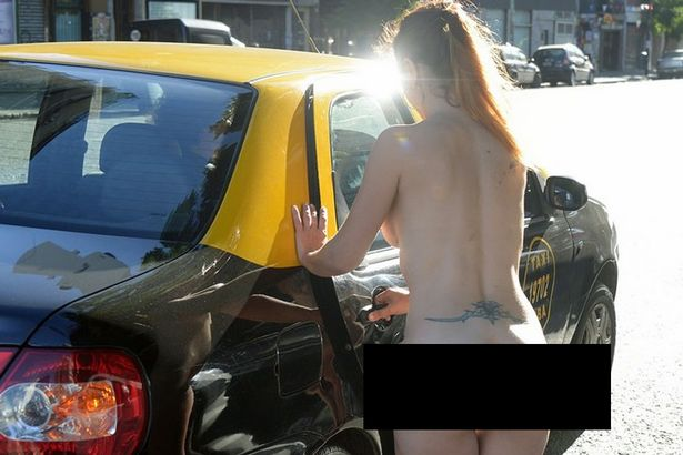 Argentinian Woman Strips Un Dress for Boyfriend in Public