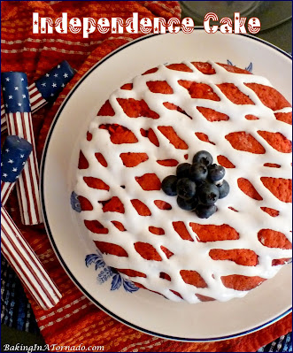 Independence Cake, to honor freedom and independence, a moist red, white, and blue cake baked with raspberries and blueberries in the layers. | Recipe developed by www.BakingInATornado.com | #recipe #cake