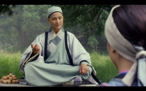 Cheng Pei-pei representa Ng Mui no filme Wing Chun.