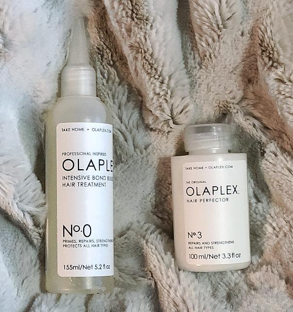 Close-up photo of Olaplex No.0 and Olaplex No.3 hair treatment products
