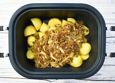 Potatoes and veggie mince in slow cooker pan