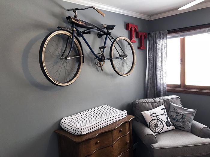 Bike on wall in nursery