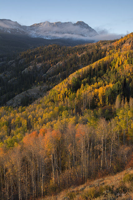 sunrise in autumn with eagles nest peak and fall colors gore range Colorado