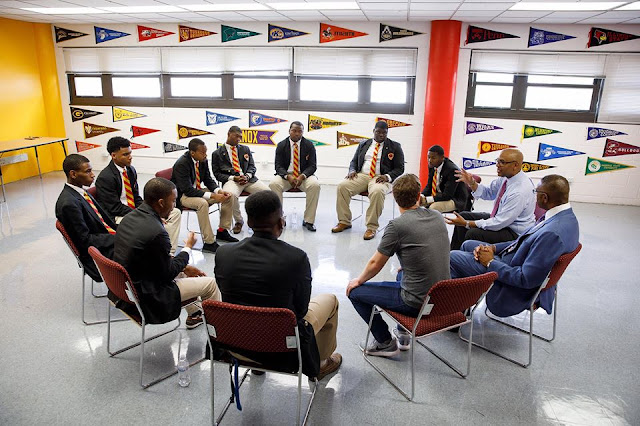 Mark Zuckerberg talking to recent grads of Urban Prep Academy