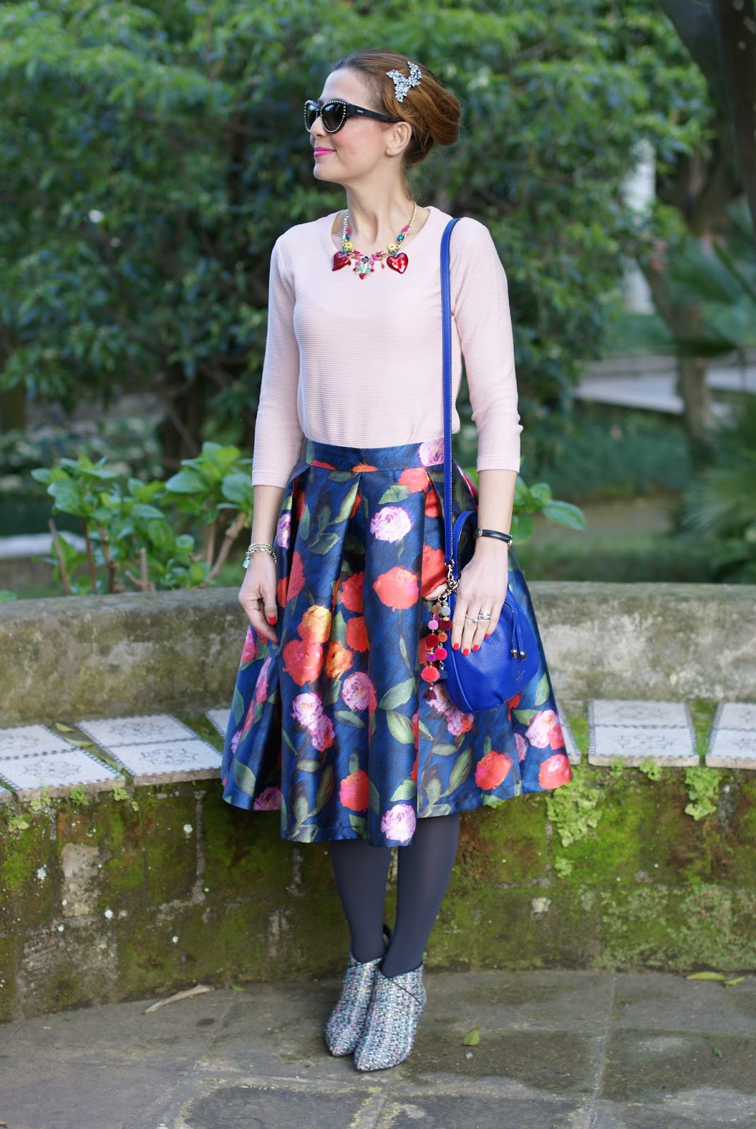 How to wear a midi skirt in Spring: floral midi skirt, tweed ankle boots, jeweled hair pin on Fashion and Cookies fashion blog, fashion blogger style