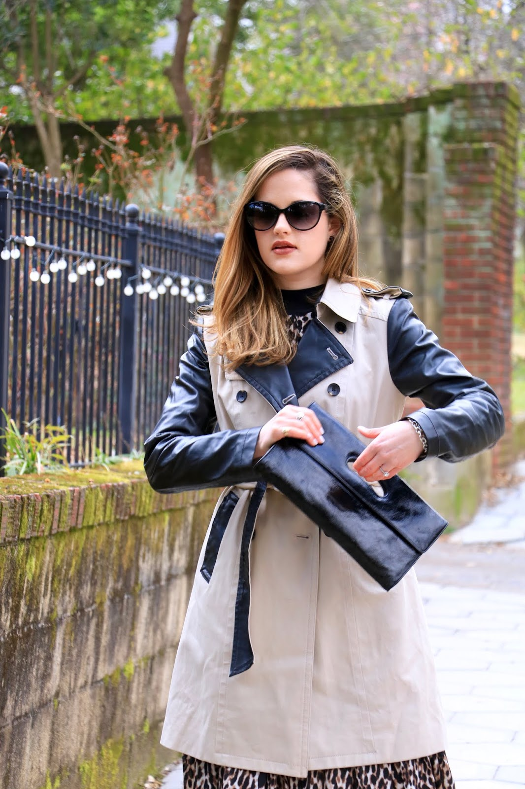 Nyc fashion blogger Kathleen Harper carrying a Hobo black patent leather clutch.