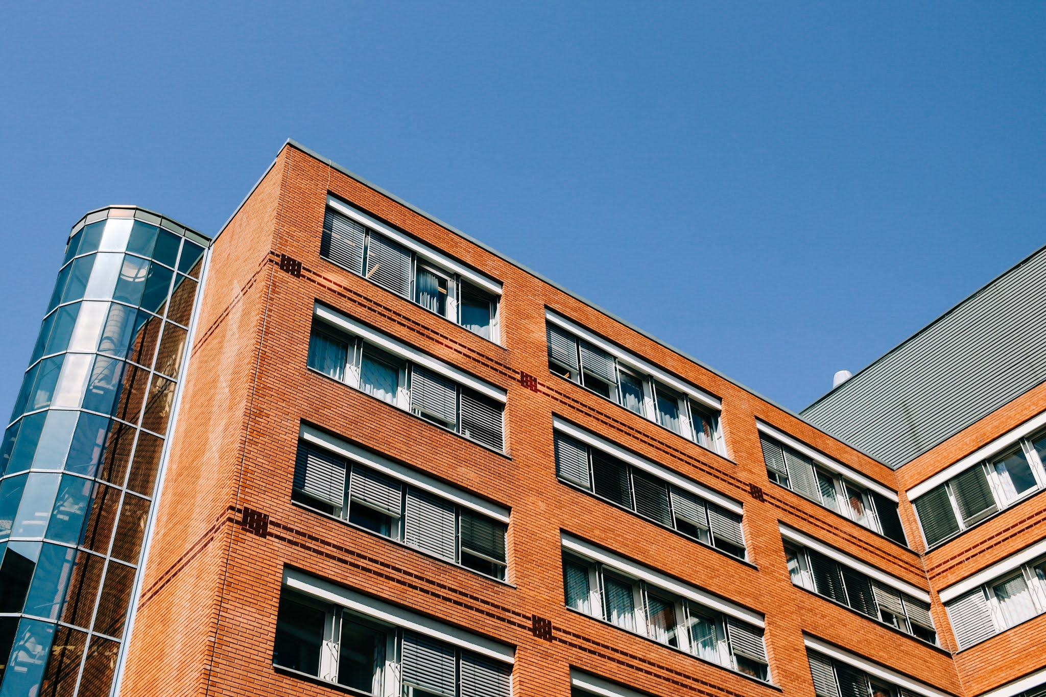 Modern apartment building with brick walls from Pexels