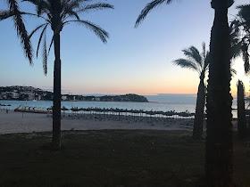 the sunset at santa ponsa beach in majorca