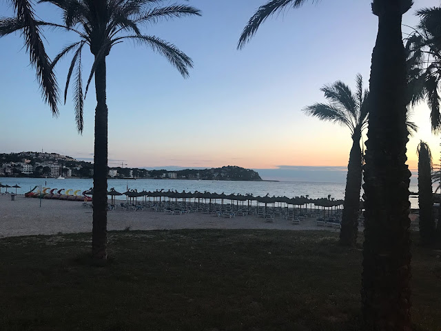 the sunset at santa ponsa beach in majorca