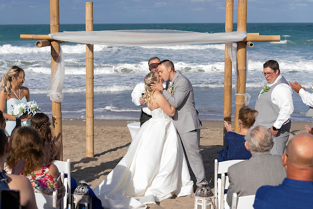 Just married Bride and Groom kissing at Ceremony