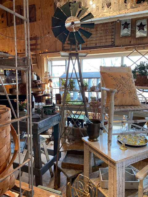 Photo of tall farm windmill in an antique shop