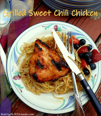 Grilled Sweet Chili Chicken is a little sweet and a little spicy. Serve right off the grill, or over a salad either hot or cold. | Recipe developed by www.BakingInATornado.com | #recipe #dinner