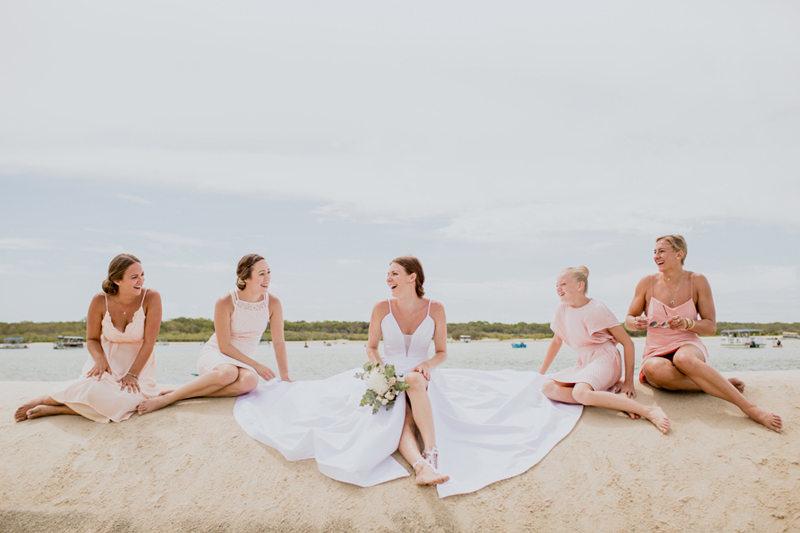 photo of bridesmaid and bride sitting
