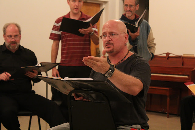 Pierre leads the Stairwell Carollers in rehearsal