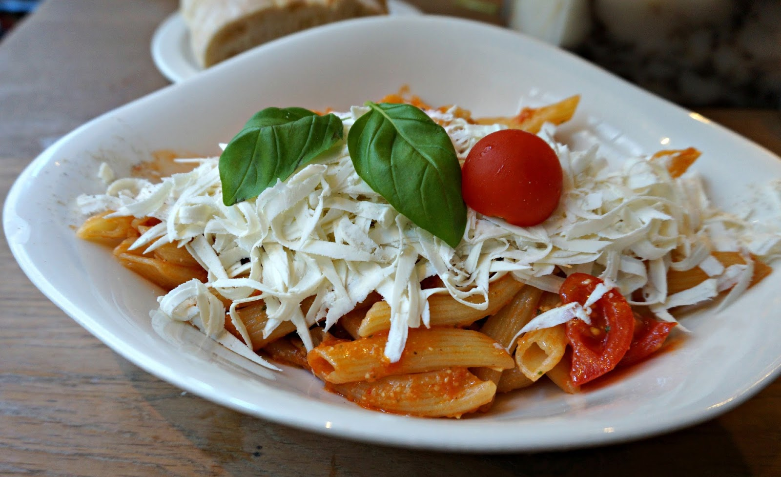 pasta dish with cheese and fresh basil