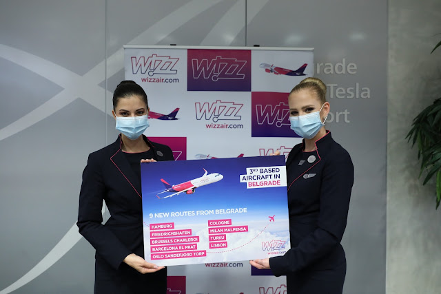 Wizz Air crew displaying card with new route launches
