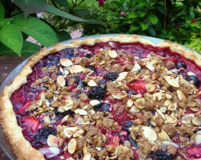 Summer Berry Pie ♥ KitchenParade.com, an all-berry pie with streusel topping. Strawberries, raspberries, blueberries, blackberries.