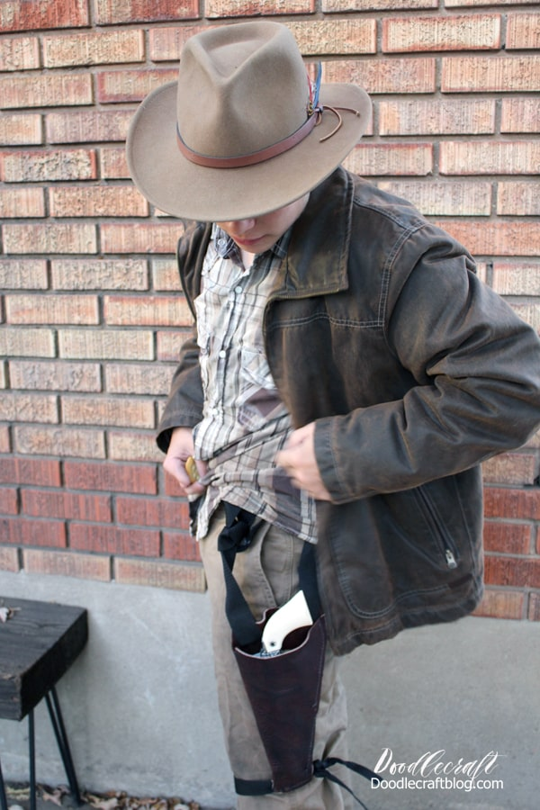 Make an Indiana Jones Halloween costume or cosplay easily with a fedora, leather jacket, button up shirt, tan pants, and a leather bullwhip...plus the Indiana Jones theme song playing on a loop!