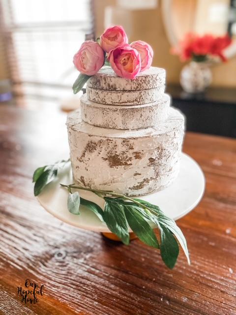 pink ranunculus naked cake topper