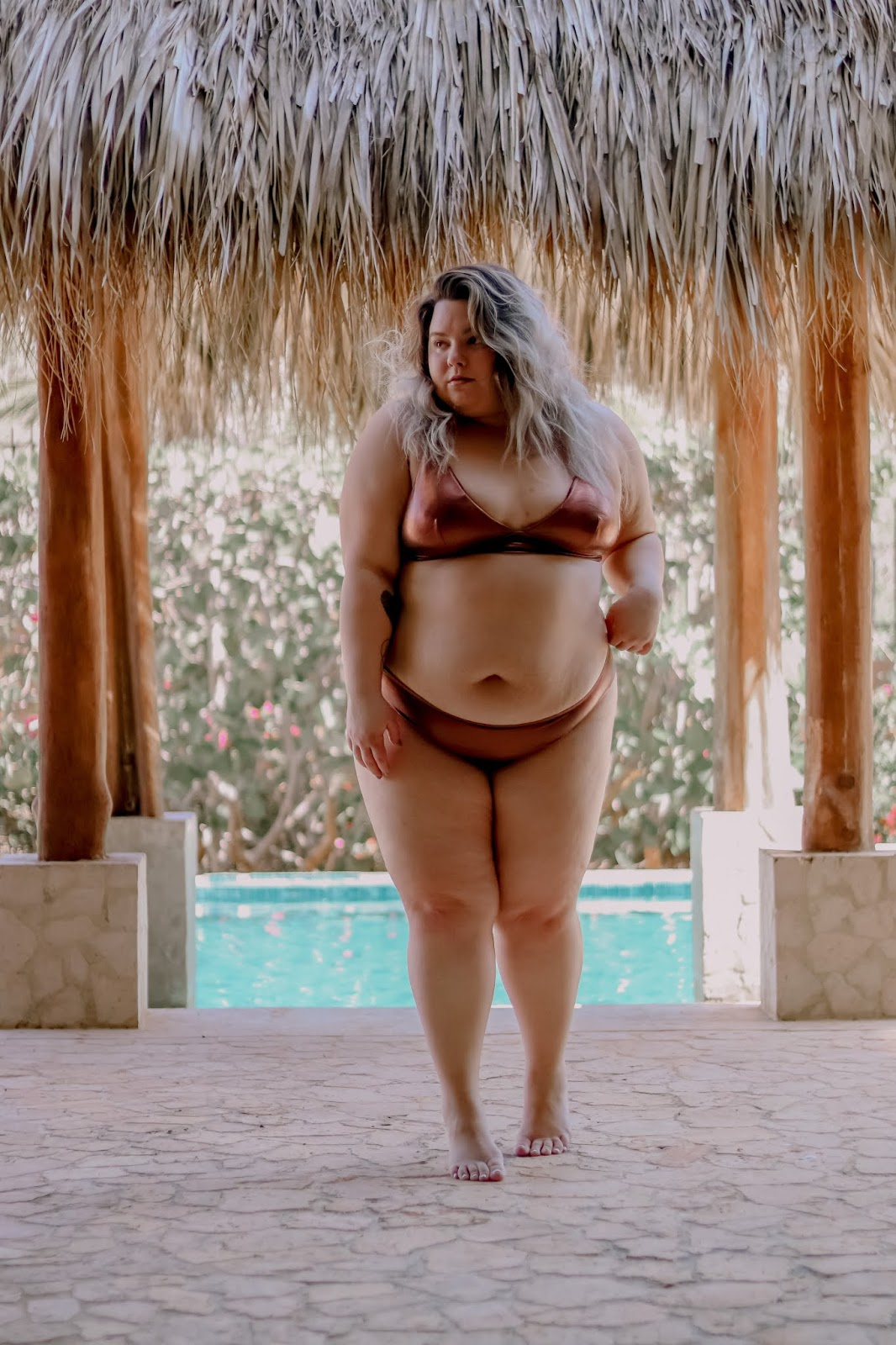 Chicago Plus Size Petite Fashion Blogger, influencer, YouTuber, and model Natalie Craig, of Natalie in the City, reviews Aerie, Torrid, and Premme metallic bikinis and swimsuits. Find out what to do and wear in Guanacaste, Costa Rica.