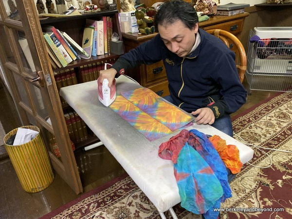 instructor irons student projects at AlpenRose cafe at Geocolor:  Hachimantai Geothermal Dyeing in Hachimantai city, Japan
