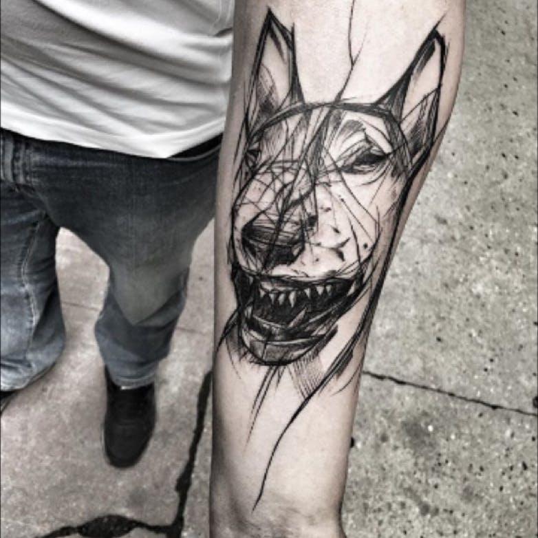 Tatuaje de perro en estilo abstracto