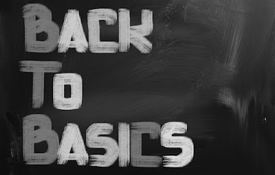 "The words ""Back to Basics"" are written in capital letters on a blackboard"