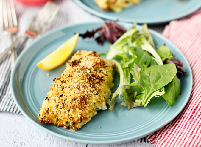 Crunchy Air Fried Cod Fillets with salad and lemon slices