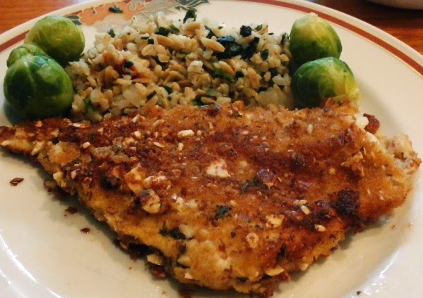 Almond crusted fish on a plate
