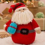 http://www.redheart.com/free-patterns/huggable-santa-pillow