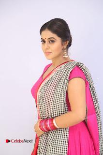 Actress Poorna Pictures in Red Salwar Kameez at Jayammu Nischayammu Raa Teaser Launch  0008