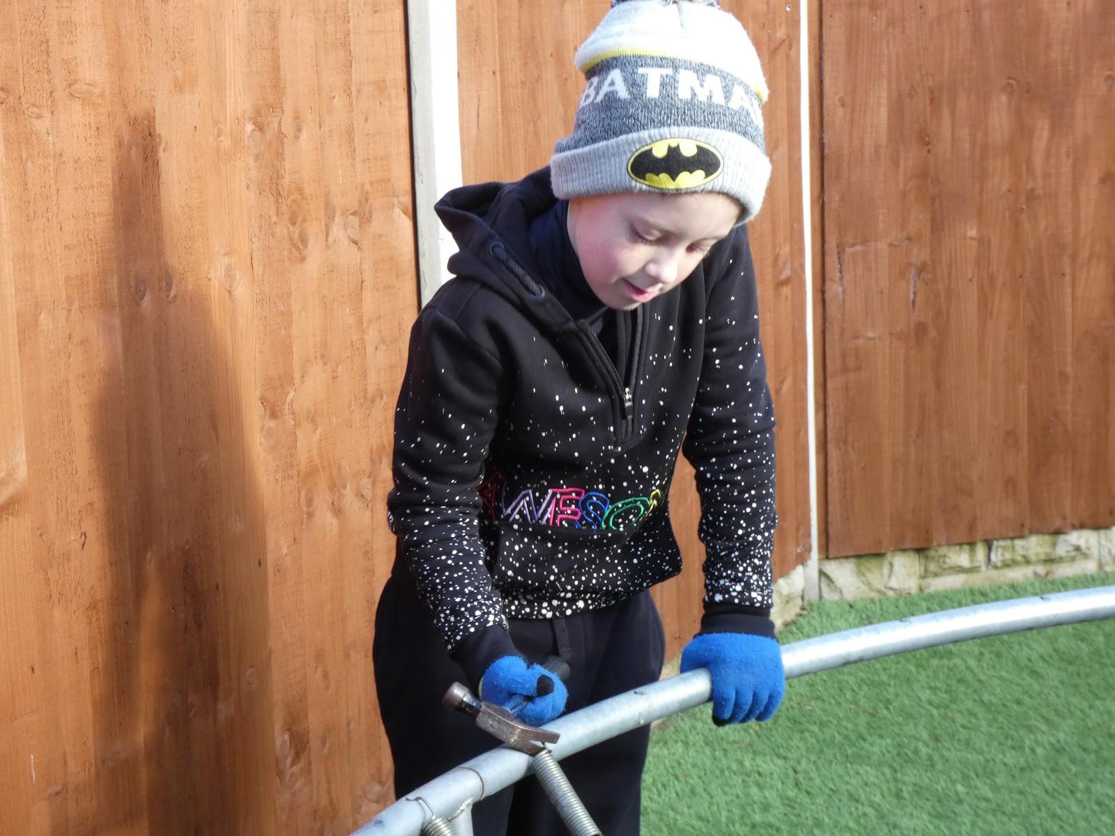 boy fixing trampoline