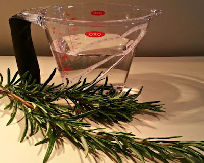 Sprigs of Rosemary and a Jug of Water