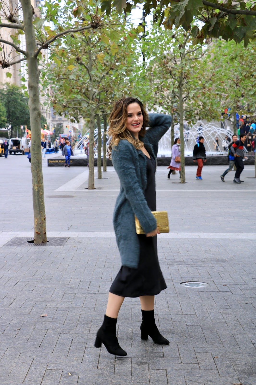 Nyc fashion blogger Kathleen Harper wearing a black slip dress outfit.