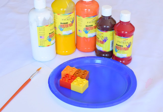 LEGO Stamped Fall Tree Craft for Kids. Use LEGO or DUPLO bricks to paint leaves in beautiful fall colors! Fun autumn printmaking activity for preschool, kindergarten, or elementary.