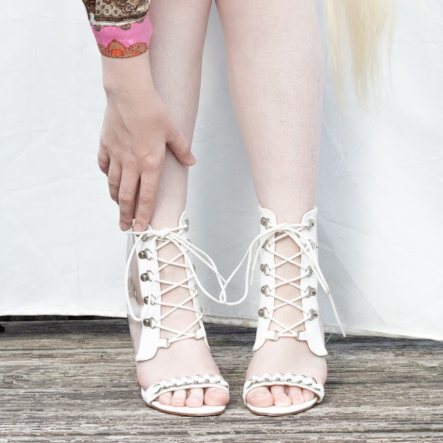 Wearing white lace up shoes
