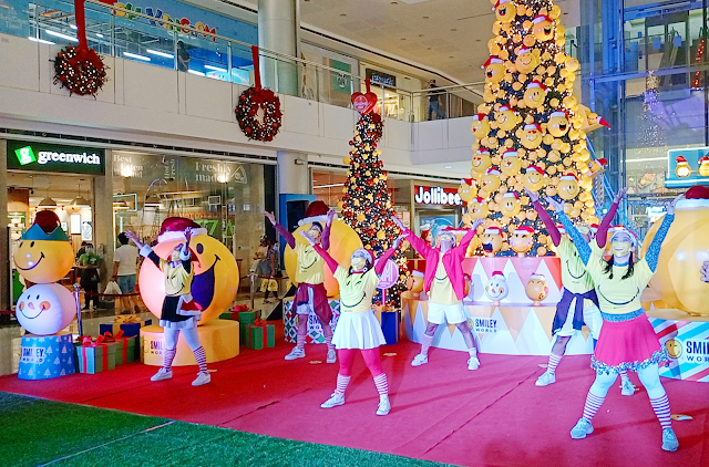 a dance mob clad in Christmas Elves garb with Smiley shirt